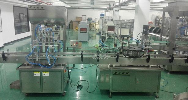 橄榄油灌装生产线,橄榄油自动灌装锁盖贴标生产线